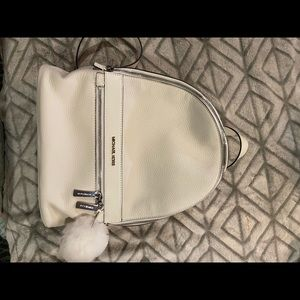 Michael Kors white backpack and matching wallet